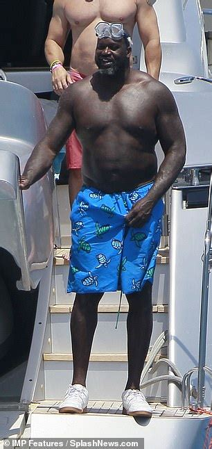 NBA legend Shaquille O'Neal goes shirtless in a pair of